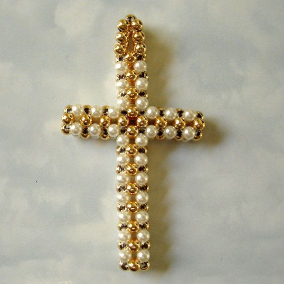 This gold tone and faux pearl beads pendant is in great vintage condition. It measures 2 3/8 tall, is lightweight, and (because of its woven construction) is flexible.