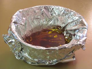 Pour cooking grease into a bowl covered in tinfoil.  Once hardened, just ball it up and throw the tinfoil away.  No clogged drains or icky messes!