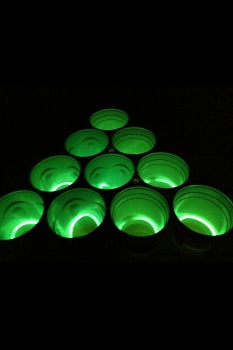 Glow bracelets in beer pong cups! Black light party