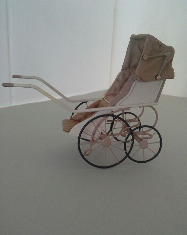 "A miniature pram made by artist Roberson. It measures 4"" high x 5"" long x apprix 2"" wide. It is marked undrneath with the artists initials CYR. It is in very good condition. 