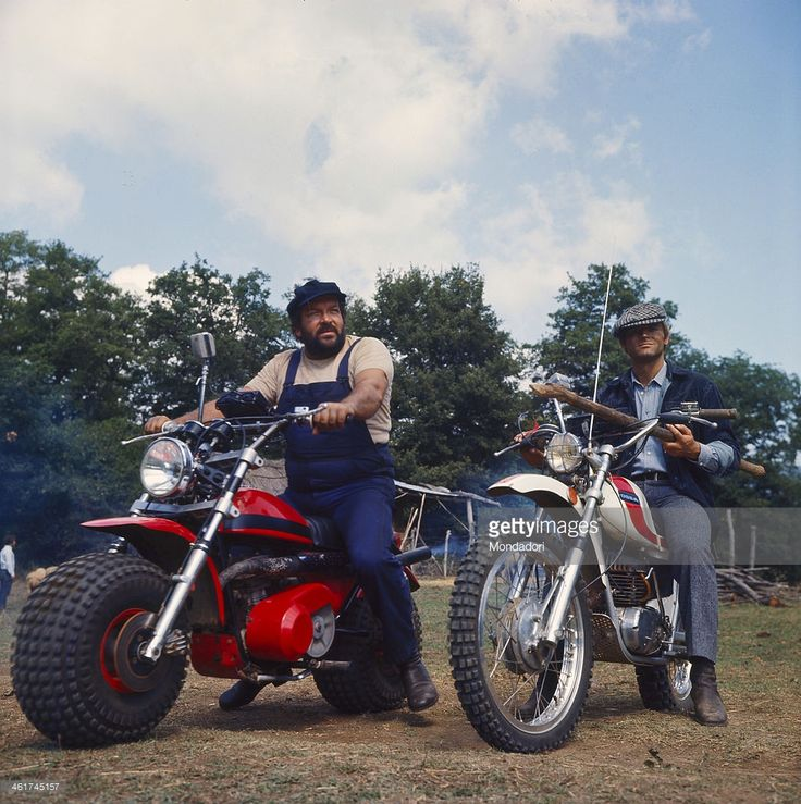 Italian actor and scenarist Bud Spencer (Carlo Pedersoli) and Italian actor, director and scenarist Terence Hill (Mario Girotti) riding two motocross in the film ...altrimenti ci arrabbiamo!. 1974