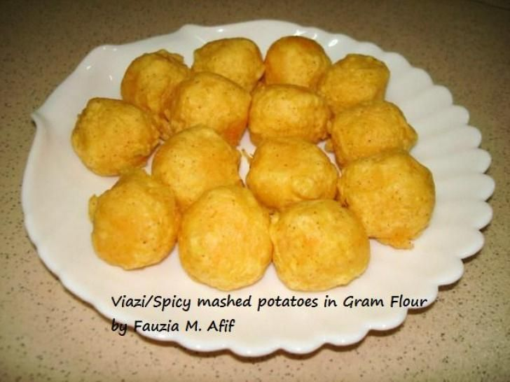 Viazi/Spicy Mashed Potatoes in Gram Flour. These simple spicy mashed potatoes coated with gram flour and deep fried are a delightful snack to have with any chutney.