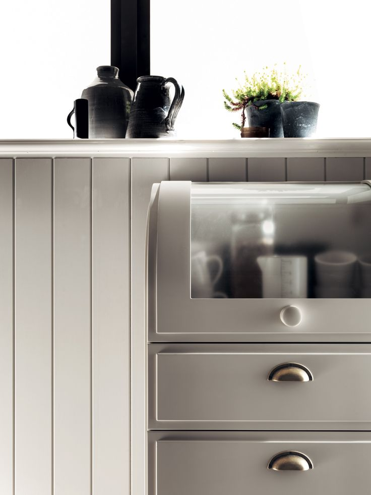 One of the Favilla's essentials is the curved door for wall unit and cupboard. Shabby chic kitchen ideas.
