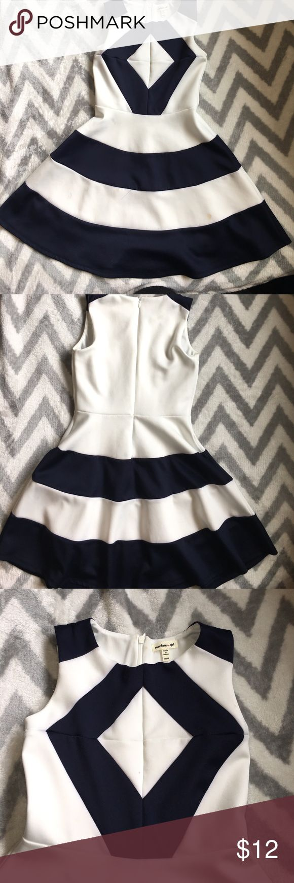 Beautiful Navy and White dress girls sz 10 Bought at Nordstrom Brand: Monteau girl size 10... Navy and White striped dress. The fit of this is perfect...tucks in at the waist and slight bell. Bought it for a wedding and everyone complimented my little one:) only worn 2-3 times. Small stain in picture.(I haven't really tried to get it out, so it could come right out) Nordstrom Dresses