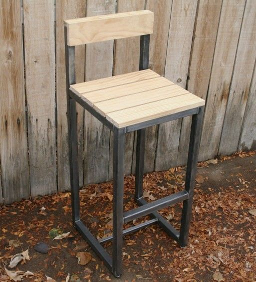 Handmade  metal bar stool.  This is a great bar stool out of steel and the wood.  Its beautiful wood, that is clear and clean.  I shined up the steel a little to make it pop, and it does.Handmade metal bar stool by jreal on Etsy, www.justinrealfurniture.com