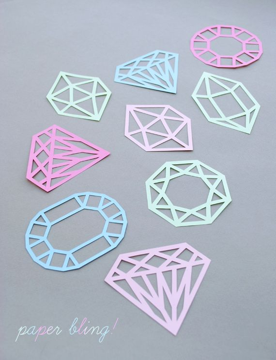 Papercut gems. Would look good cut in black paper/ card and coloured tissue paper stuck behind or sandwiched between two 'gems'.