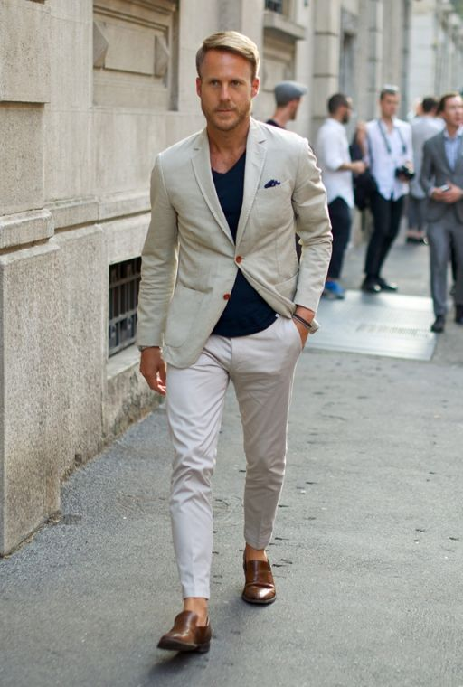 Go for a beige blazer and white chinos to create a smart casual look. Dark Brown Leather Loafers are a savvy choice to complete the look.  Shop this look for $297:  http://lookastic.com/men/looks/pocket-square-and-blazer-and-v-neck-t-shirt-and-chinos-and-loafers/3895  — Navy Polka Dot Pocket Square  — Beige Blazer  — Navy V-neck T-shirt  — White Chinos  — Dark Brown Leather Loafers