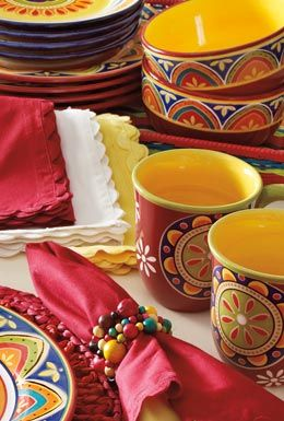 Love the Mexican style dinnerware!Pier One has amazing things.for a fabulo. Colorful mexican home.