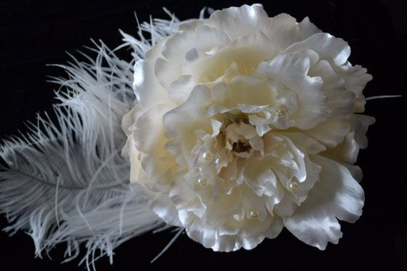 Large Off white peony flower on a comb. Surrounded by white ostrich feather.