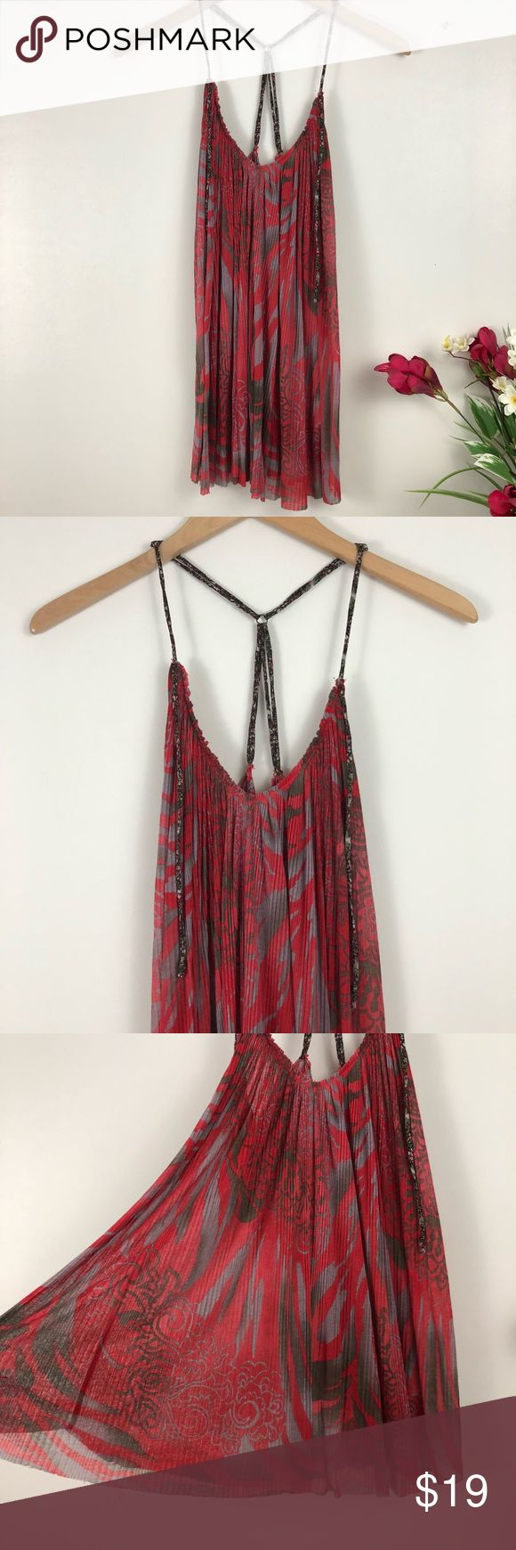 Free People Chiffon Strappy Pleated Tank Top Semi-sheer chiffon tank top from Free People. The pattern is on a ten background. It features adjustable straps and a Raw neckline and hem. It's Pleated all over which allows it to drape nicely. It's in excellent condition with no flaws. (Location) {no trades - no modeling} Free People Tops Tank Tops