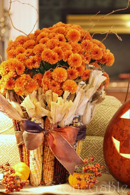Autumn inspiration using dried corn and mums tied up in a bow ~ cute