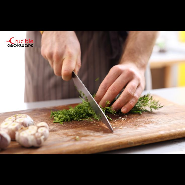 Chopping dill with Crucible Cookware kitchen knife
