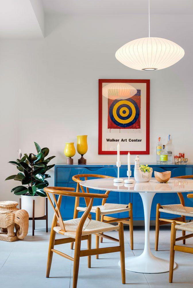 Vibrant dining room design with blue glossy cabinet and colorful decorations | Lucy Interior Design