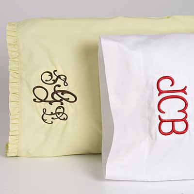 just a pair of pillowcases, with an extra-fancy monogram in their dorm room colors