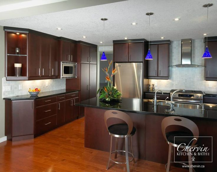 Deep Brown Kitchen Cabinets that compliments stainless steel appliances. Low height stools. #customcabinetry