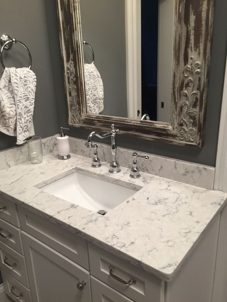 "His and Hers Vanities showing framed mirrors continues to add to the theme of ""old world class"""
