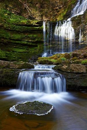 Back in the Saddle    @   by  :     Paul Sutton   ---   Afternoon sun light the upper falls of Scaleber Force. Situated near to Settle in the Yorkshire Dales, these falls are frequented by many a photographers Wellington boot and tripod.