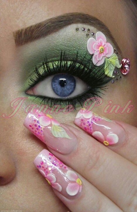 Love the eye make up - screw the nails :D