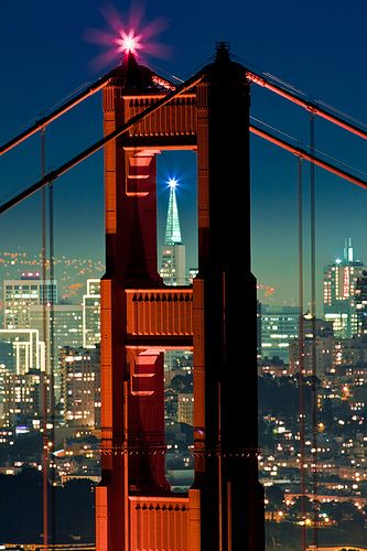"""Golden Gate Bridge, North Tower, San Francisco"" by Raj Hanchanahal Photography on Flickr - A view of Transamerica Pyramid Building at night through the north tower of the Golden Gate Bridge from Marin Headlands."