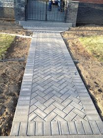 herringbone paver pattern for the walkways and garden area kels