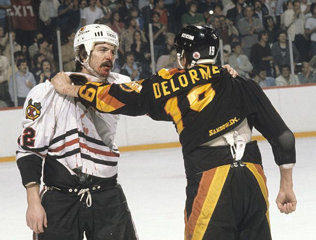 Grant Mulvey and Ron Delorme take a rest after brawling during a 1982 Canucks-Blackhawks game.