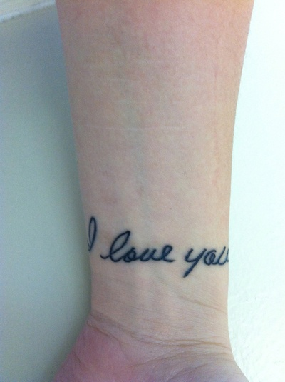 Done by Dan Collins at Bluz Tattooz in Waterford, MI. I got this done as a present to myself for deciding never to cut again. Done is my late mother's handwriting, covering a few yet-to-fade scars.
