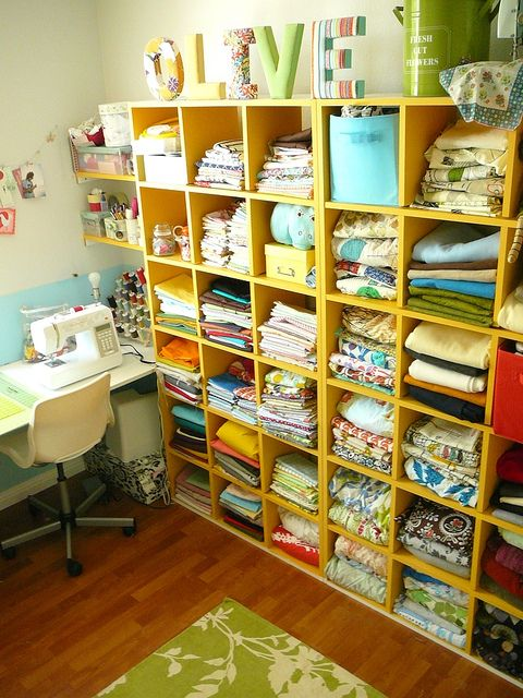 My Sewing Room BY Fallon Akers @Flickr: My sewing room has never been completely ... completed. Here is what it currently looks like. I recently painted the wooden shelving orange (thanks dad for building them!): Organization, Fabric Storage, Sewingroom, Sewing Craft Room, Storage Idea, Craftroom, Sewing Rooms, Craft Rooms