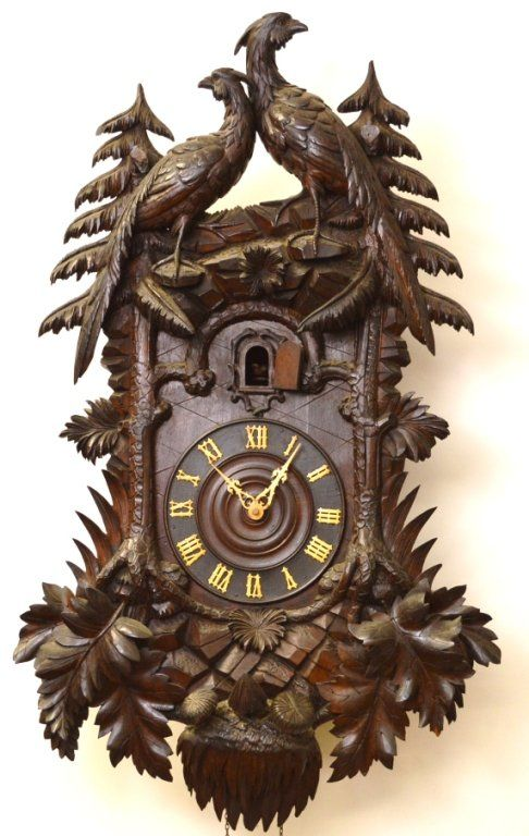 """A fine example of a 19th Century Black Forest Cuckoo Clock with Roman numeral hands. 37 x 22"""" with weights and base to pendulum."""