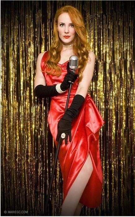 Simone Simons sexy red-headed female mezzo-soprano singer of Dutch symphonic metal band EPICA. More Epica at http://astore.amazon.com/epica-20