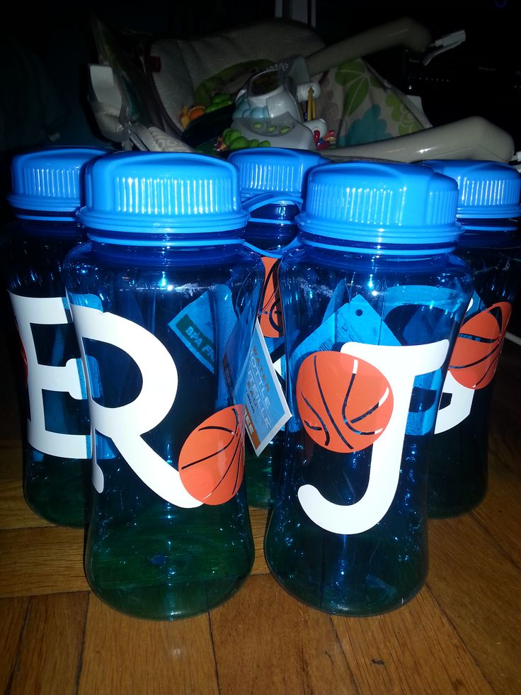 Basketball party water bottles with custom decals of initial and a basketball for each child.