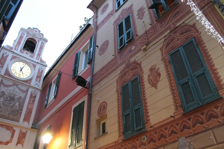 Loano's watchtower and buildings with trope l'oeil decorations. Typical Ligurian architecture.