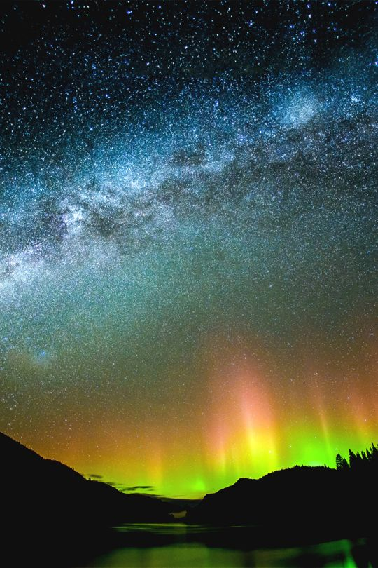Milky way and the Northern lights at the Jacques-Cartier National Park, Quebec, Canada