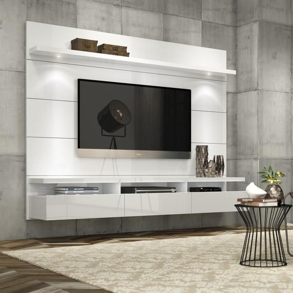 Enjoying a quiet intimate evening at home? Your TV has never looked better mounted on the Cabrini Floating Entertainment Center. Simply attach it to the panel using the built-in TV mount, lie back, re