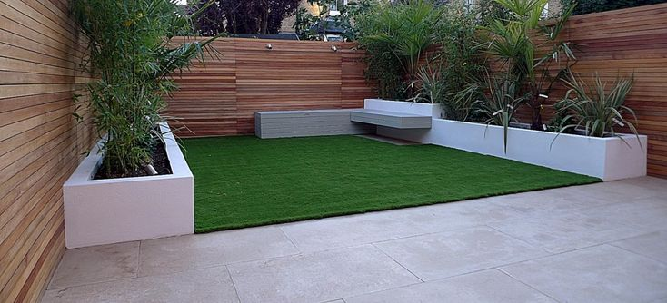 modern garden design raised beds hardwood privacy screen ceadr trellis fence artificial grass floating storage bench earlsfield wandsworth clapham dulwich balham london