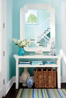 """The walls in the foyer are painted Spring Sky by Benjamin Moore, """"the most pleasing shade of blue I ... - Photo: David A. Land; styling: Lindsey Ellis Beatty and Rachael Burrow"""