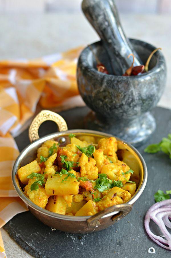 Punjabi Alu gobhi- Absolutely delish cauliflower #vegan side dish w/ potatoes and typical spices.