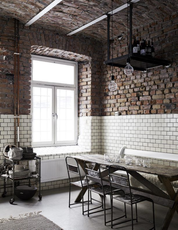 Industrial style dining space | exposed brickwork, subway tiles and bare bulb