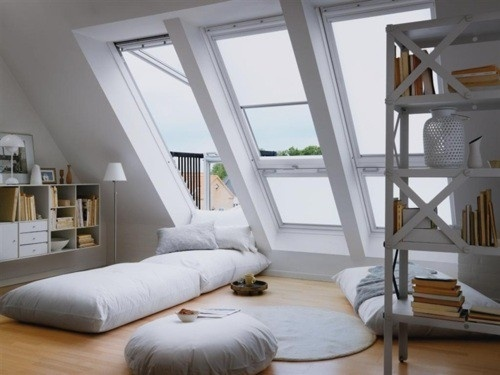 Skylights Provide Light & Space in Attic Conversion by Husqihussey