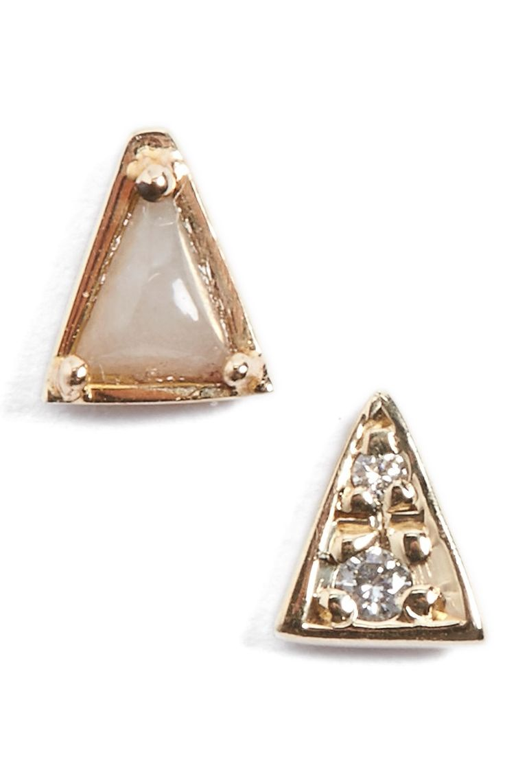 The triangular shape unites these two mismatched yellow gold stud earrings that feature a smooth, semiprecious-stone and two twinkling diamonds.