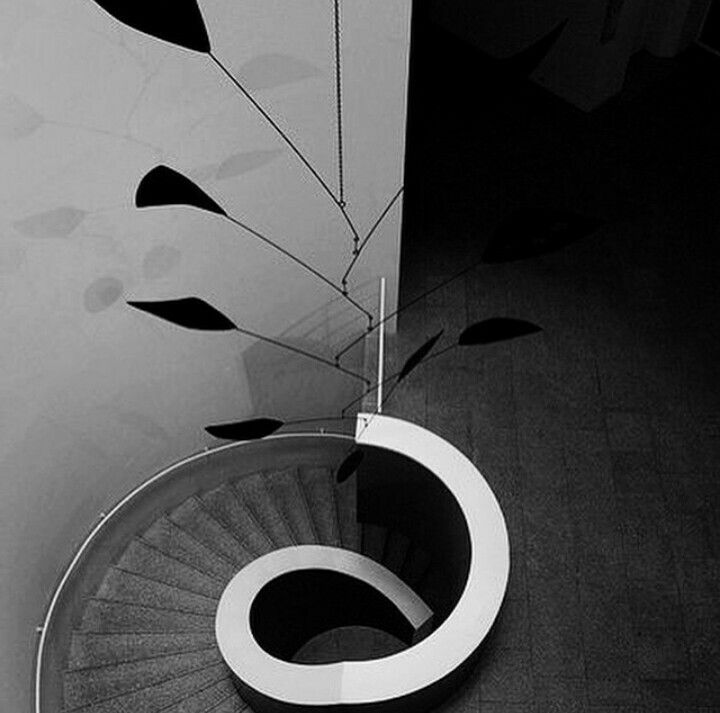 adorable Alexander Calder black MOBILE-  and what an inspired hanging!
