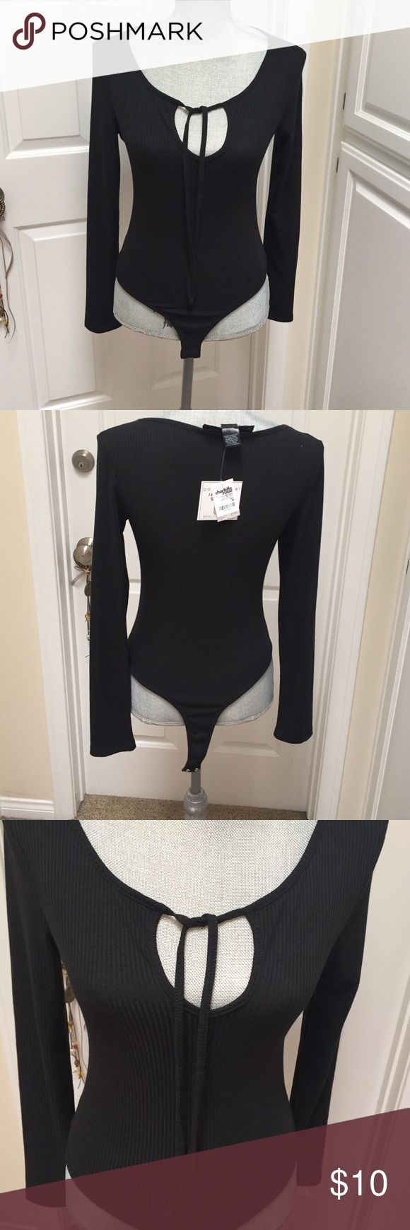 Charlotte Russe black long sleeve bodysuit Charlotte Russe black long sleeve bodysuit  with open cut in front with strings for can tie. Two snaps on bottom. NWT. As is Charlotte Russe Tops