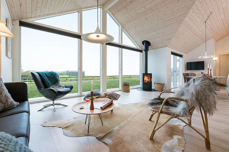 View in gallery Large glass windows and stunning gabled roof design define the summer home