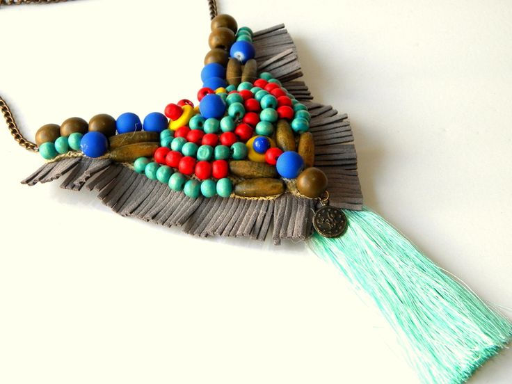 handmade necklace with silk, leather fringes and wooden beads