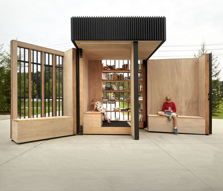 The Story Pod, a modern tiny library and gathering space built by town employee volunteers in Newmarket, Ontario, folds up and illuminates at night.