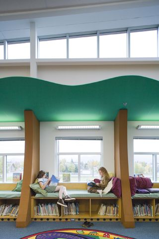 Library window seats designed with a tree theme
