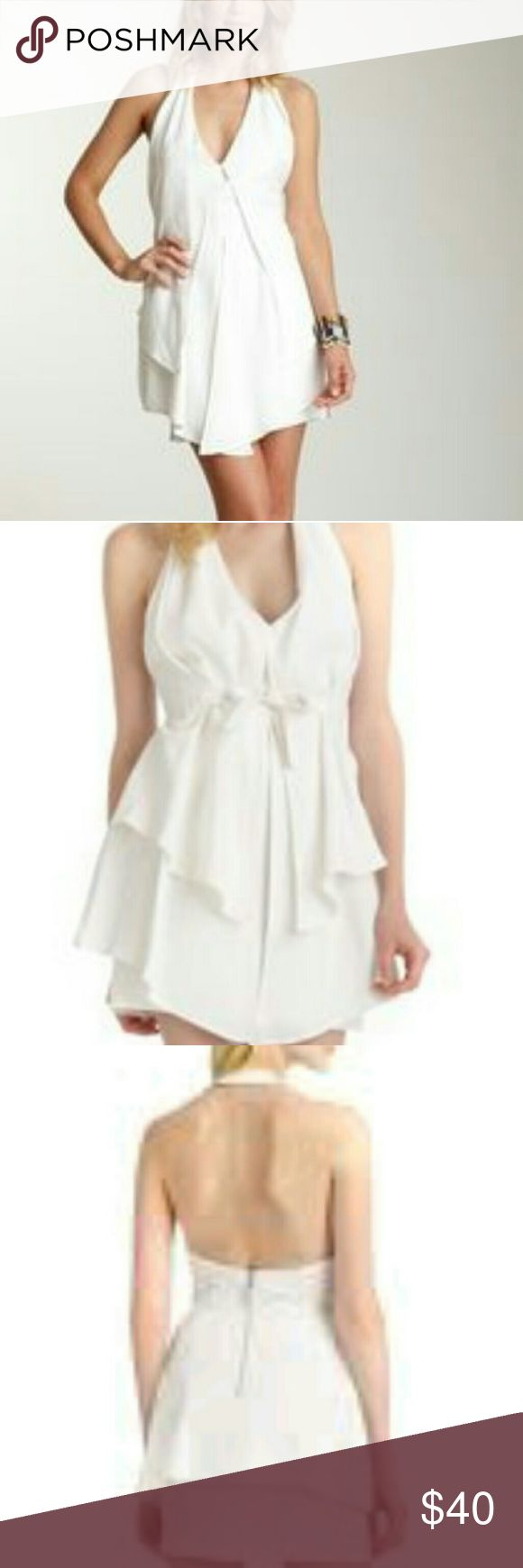 Stella&Jamie Zambia white halter dress sz.XS Stell&Jamie Zambia white halter dress sz.XS, sleeveless exposed back, tiered with pleating and tie,haute look,new with tags ,shell 100%tencil,lining 100%polyester, beautiful casual and easily dressed up too,mini flowey boho haute look,wear to the beach and or to a 5 star restaurant on the beach Stella&Jamie Dresses Mini