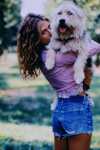 jennifer aniston with norman, her dog that she got his name tattooed on her foot.  She's my idol!...no mans name on this body but my dog...he's all mine!!!