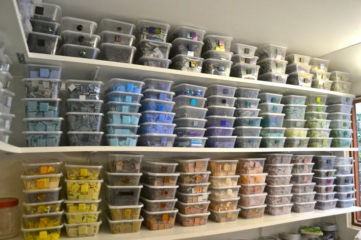 Okay, wow.  I love this.  All those tiles, all those organized colors, all those clear plastic containers...