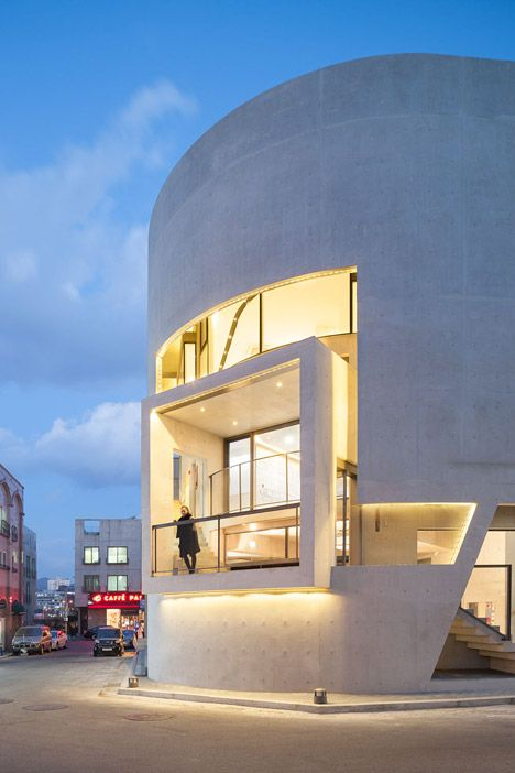 """After being asked to create """"the most outstanding building in the region"""", Korean architect Moon Hoon inserted a protruding balcony within the curving frontage of this music agency."""