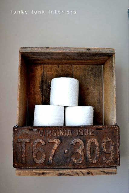 Super quirky old crate and license plate toilet paper storage for the bathroom. via Funky Junk Interiors
